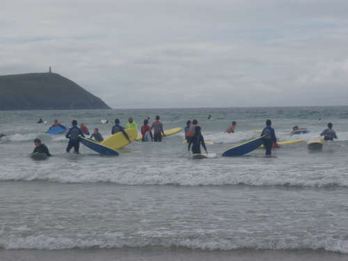 A few of the group surfing