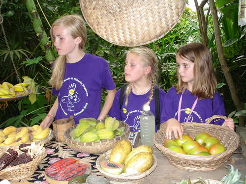 Girls selling the fruit in the rainforest at Eden Project